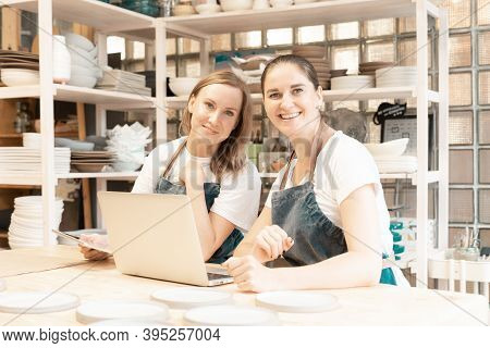 Two Female Entrepreneur With Laptop In Artisan Workroom. Waist Up Portrait Of Cheerful Business Woma