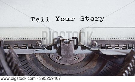 Vintage Typewriter With Text Related To Marketing, Business Or Finance. Inscription Tell Your Story