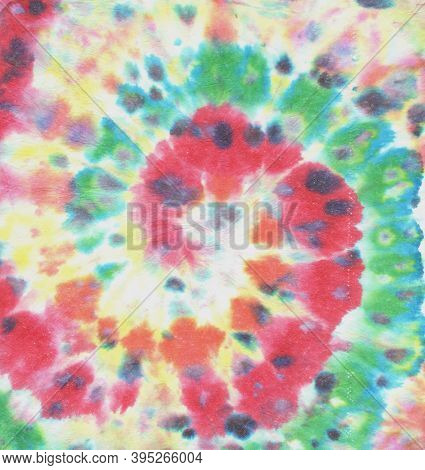 Rainbow Tye Dye Spiral. Dyed Texture. Rainbow Watercolor Roll. Fabric Design. 1960s Style Background