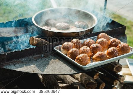 Beef And Pork Patty For Burger. Cooking Cutlets On Mangal. Grill Minced Meat. Chef Cooks Burger In S