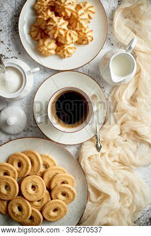 Sweet dessert concept. Golden crunchy cookies served with cup of black coffee