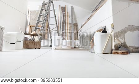 Low Angle Of Indoor Shot Of Construction Or Building Site Of Home Renovation With Tools On White Flo