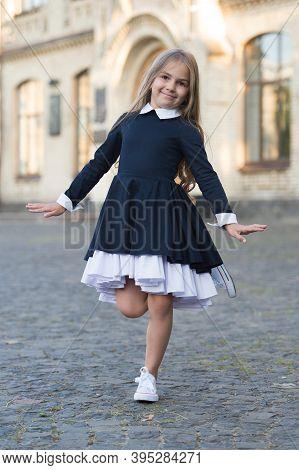 Happy Small Ballet Dancer In School Uniform Balance On Leg Outdoors, Ballerina.