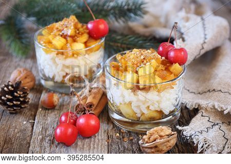 Two Glass Of Rice Milk Cream  Pudding With Caramelized Apple And Praline, New Year Dessert,  Christm