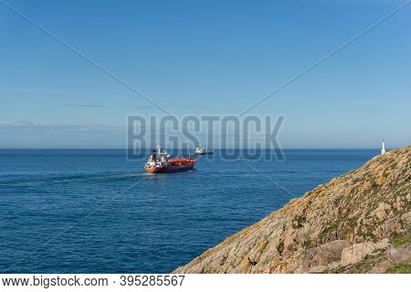 Avilés, Asturias / Spain - 7 November 2020: Freight Ships Leaving The Industrial Port In Aviles And