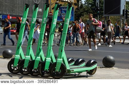 Bucharest, Romania - July 23, 2020: Bolt Electric Scooters Are Parked On A Sidewalk In Bucharest. Th