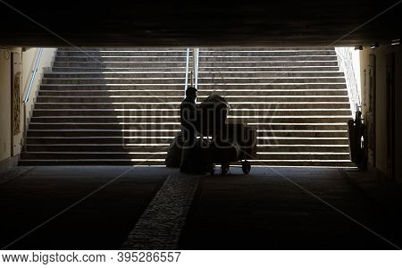 Bucharest, Romania - April 09, 2020: A Man Is Carrying Large Bags With Goods For A Store Through The