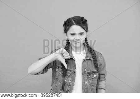 Turning Thumbs Down. Unhappy Child Give Thumbs Down Blue Background. Gesturing Thumbs Down. Thumbs D