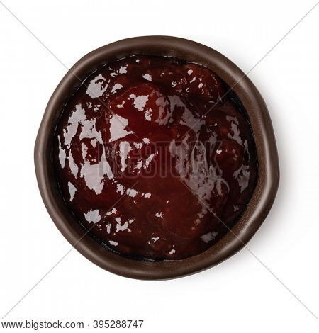 glass bowl of red berry jam isolated on white background