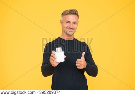 Happy Attractive Man In Casual Style Show Thumbs Ups Hand Gesture Holding Eau De Toilette Yellow Bac