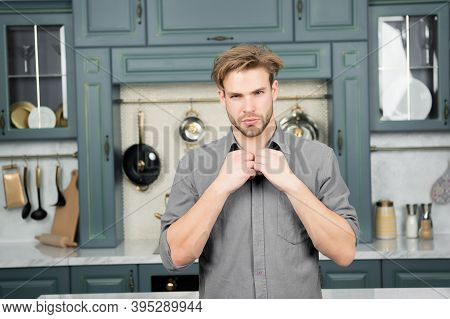 Macho In Blue Shirt Fix Collar On Kitchen. Food Preparation, Cuisine, Cooking Concept. Fashion, Styl