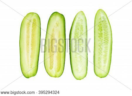 Sliced Cucumber And Cucumis Melo Isolated On White Background