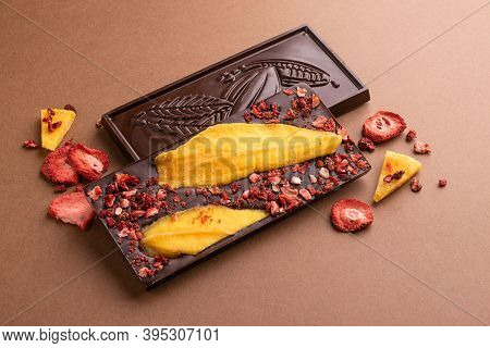 Chocolate Dark Belgian Bar With The Addition Of Fruit Slices Of Strawberry Mango