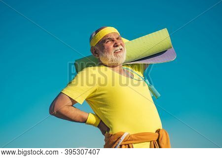 Fit Senior Man Resting After Working Out. Senior Sportsman In Sport Center. Sporting. Portrait Of He
