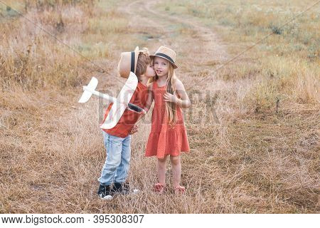 Valentine Day. Beautiful Little Couple - Boy And Girl Embracing. Childhood Memories. Romantic And Lo