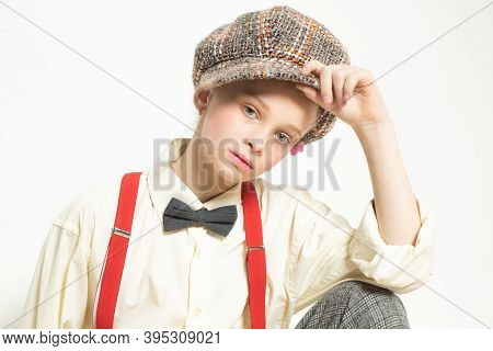 Confident In Her Style. Teen Girl In Retro Suit. Suspender And Bow Tie. Old Fashioned Child In Check