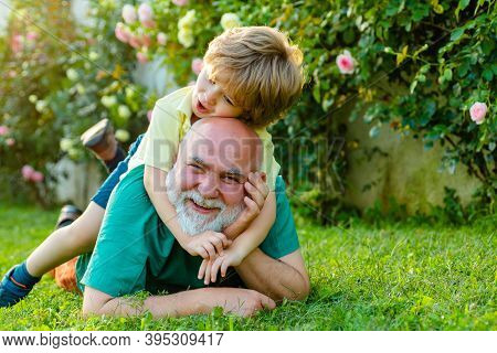 Grandfather And Son. Family Summer And Active Holidays. Happy Senior Man Grandfather With Cute Littl