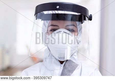 Close Up Portrait Of Exhausted Doctor With Face Shield And Face Mask Against Fight With Coronavirus.