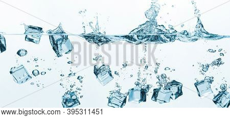 Falling Ice Cubes In Water Splashes Isolated On White Background. Ice Cubes Splashing Into Clear Wat