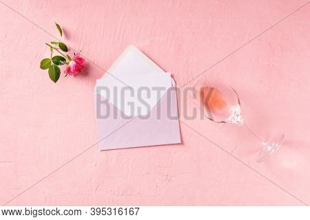Romantic Greeting Card Mockup, A Flat Lay With A Pink Rose And Rose Wine
