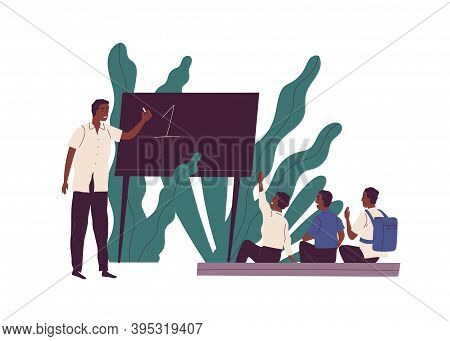 African American Teacher Explaining Math To Children Near Blackboard In Poorly Equipped Classroom. E