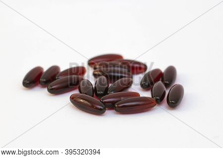 Curcumin Capsules Lie On A White Background. Strengthening The Immune System. The Photo