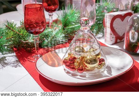 Glass Vase In The Form Of A Christmas Tree With Christmas Balls Inside. Christmas Decorations For Th