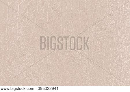 Beige creased leather textured background