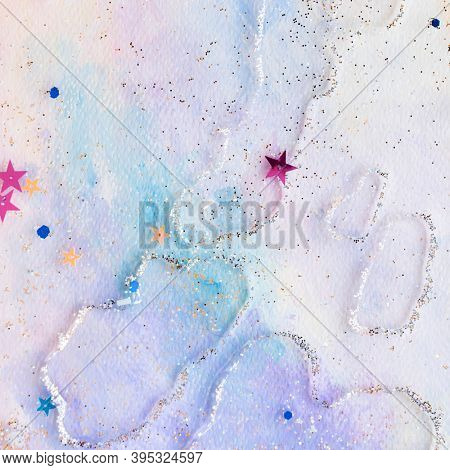 Glittery star confetti on colorful abstract pastel watercolor background