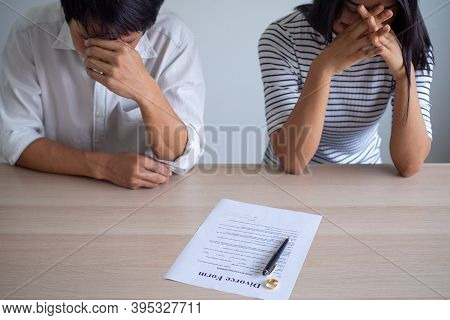 Couple Is Feeling Stressed After Agreeing To Sign A Divorce Certificate. Concepts Of Lovers Having F