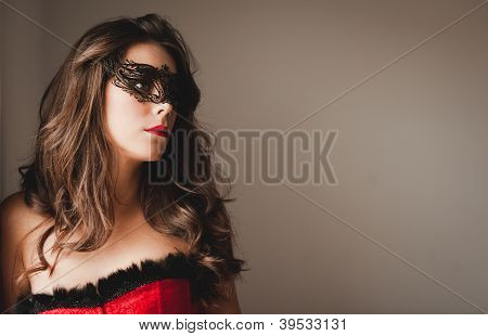 Sexy masked girl looking away