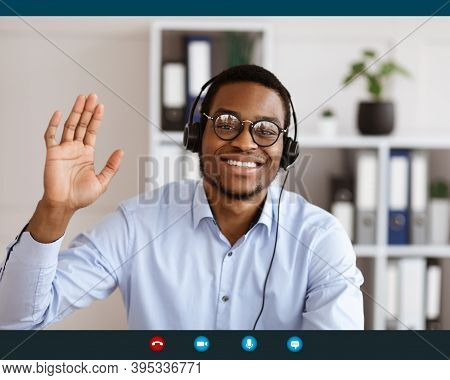 Smiling African American Young Man Employer Consulting Customers From His Office Online Via Applicat