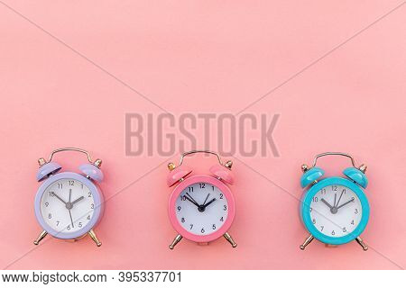 Simply Minimal Design Three Ringing Twin Bell Classic Alarm Clock Isolated On Pink Pastel Background