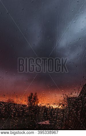 Drops On Glass In Rainy Day. Rain Outside Window In Autumn Day. Texture Of Raindrops, Wet Glass. Rai