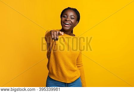 Gotcha. Laughing Black Lady Pointing Index Finger At Camera, Indicating Somebody, Positive African A