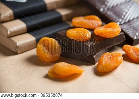 Close-up Dried Fruits On Chocolate Isolated On Craft Paper Background