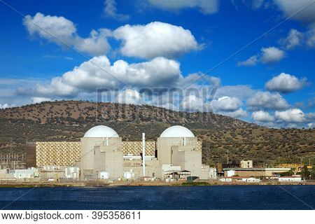 Nuclear power plant below a amazing blue sky with floffy clouds