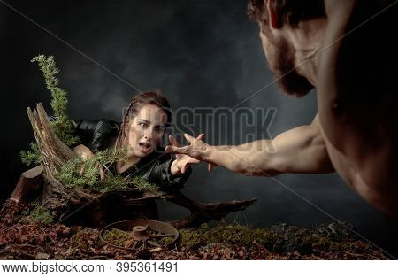 The Young Man Rescues The Girl By Holding Out His Hand To Her. The Image On The Theme Of The Post-ap