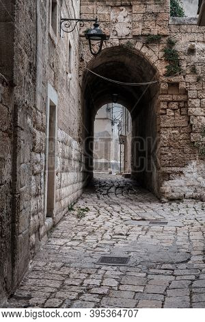 Narrow Street In The Old Town, Stone Walls, Arched Passage, Lantern. Monopoli, Italy.