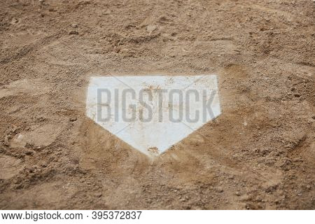 A Dirty Home Plate Of A Baseball Infield Viewed From Above