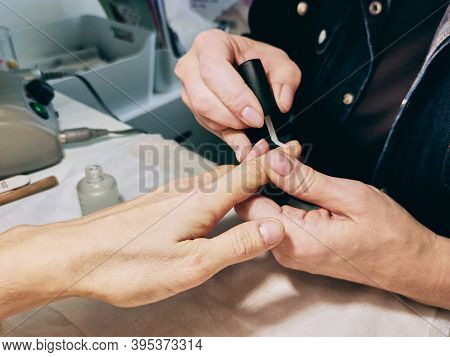 Closeup Of Beautiful Female Hands Applying Transparent Nail Polish On Healthy Natural Womans Nails I