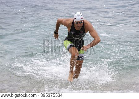 Istanbul, Turkey - October 18, 2020:  Undefined Athlete Competing In Swimming Component Of Istanbul