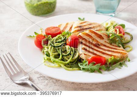 ketogenic paleo diet lunch. halloumi cheese, spiralized zucchini with arugula pesto and tomatoes