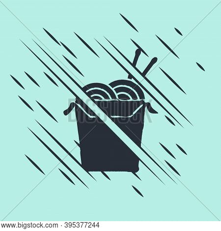 Black Asian Noodles In Paper Box And Chopsticks Icon Isolated On Green Background. Street Fast Food.