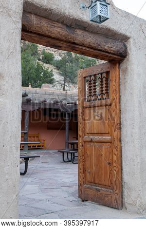 An Elaborately Carved Wooden Door At The Entrance To A Cafe And Gift Shop At Bandelier National Monu