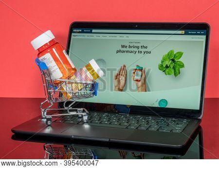 Morgantown, Wv - 18 November 2020: Minature Shopping Cart Holding Prescription Drugs In Front Of Scr