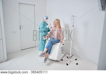 Nurse Performing A Pharyngeal Swab In The Woman