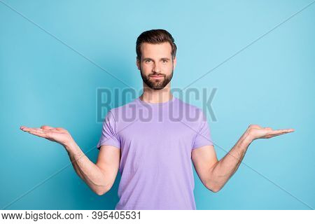Photo Of Young Handsome Man Hold Palms Balance Scales Compare Product Offer Advert Isolated Over Blu