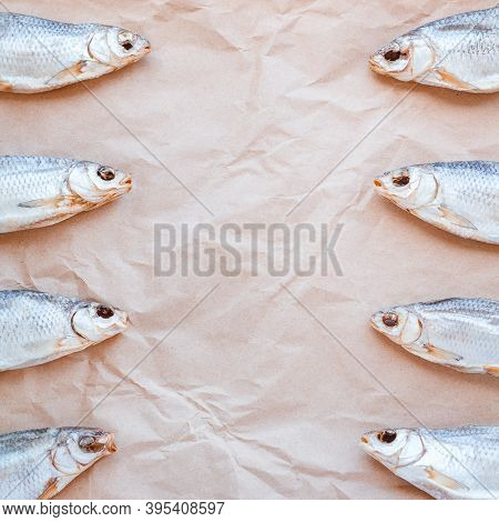 Dried Fishes Template Banner On Craft Paper Background With Empty Space For Text. Flat Salted Roach
