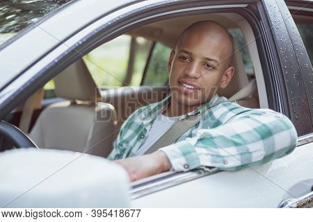 Handsome African Man Smiling, Looking Away, Sitting In His Car On Countryside Roadtrip, Copy Space.